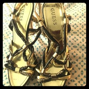 Gold and black sandals